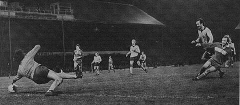 David Armstrong scores the winner as Keith Mead and Alan Phillips look on